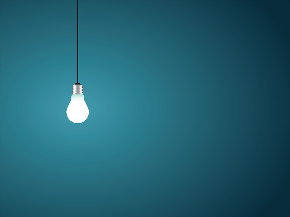 light bulb isolated against teal background